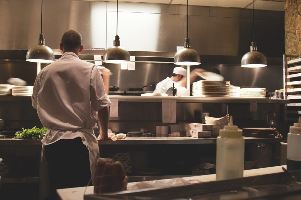 Clean restaurant with a busy staff preparing food
